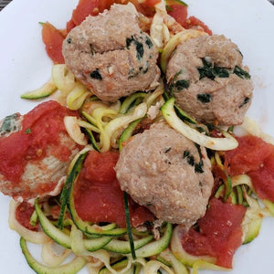 Spinach Garlic Turkey Meatballs over Zoodles with Tomatoes