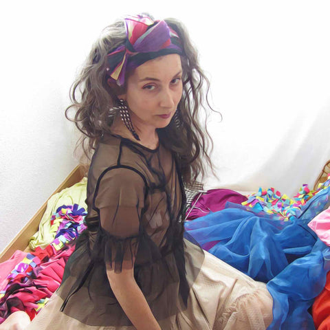 Alex Mitchell surrounded by a heap of clothes, going through her wardrobe figuring out her personal style.