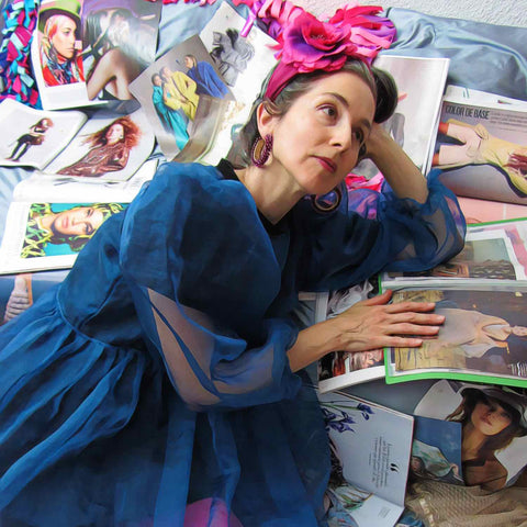 Alex Mitchell surrounded by lots of fashion magazines dreaming about her future fabulous self.