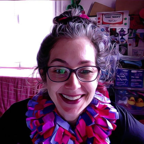 Alex Mitchell all smiles with her colorful lush boa scarf on, after getting ready for her video meeting in a hurry.