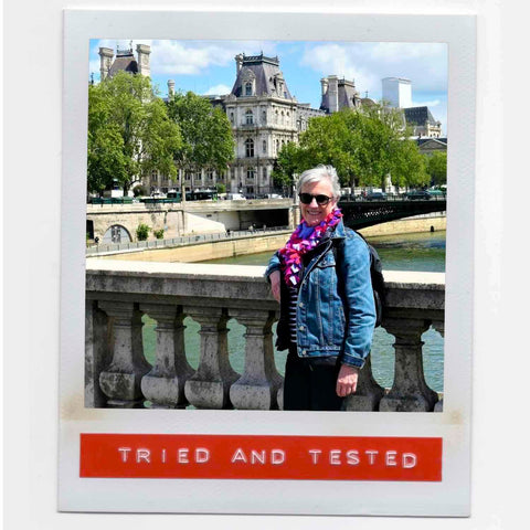 Pat feeling happy wearing her lush colorful fashion boa scarf with style with casual denim outfit while walking around Paris.