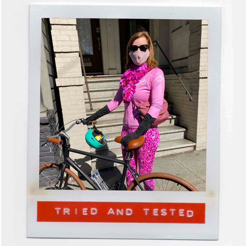 Melinda feeling fab wearing her happy multicolor fashion boa scarf with style while riding her bike around San Francisco.