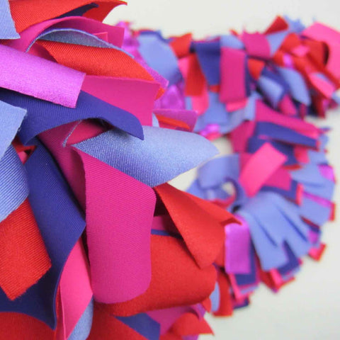 Lush non feather fashion boa scarf made of soft synthetic multicolor fabrics in bright colors with hand cut fringe.
