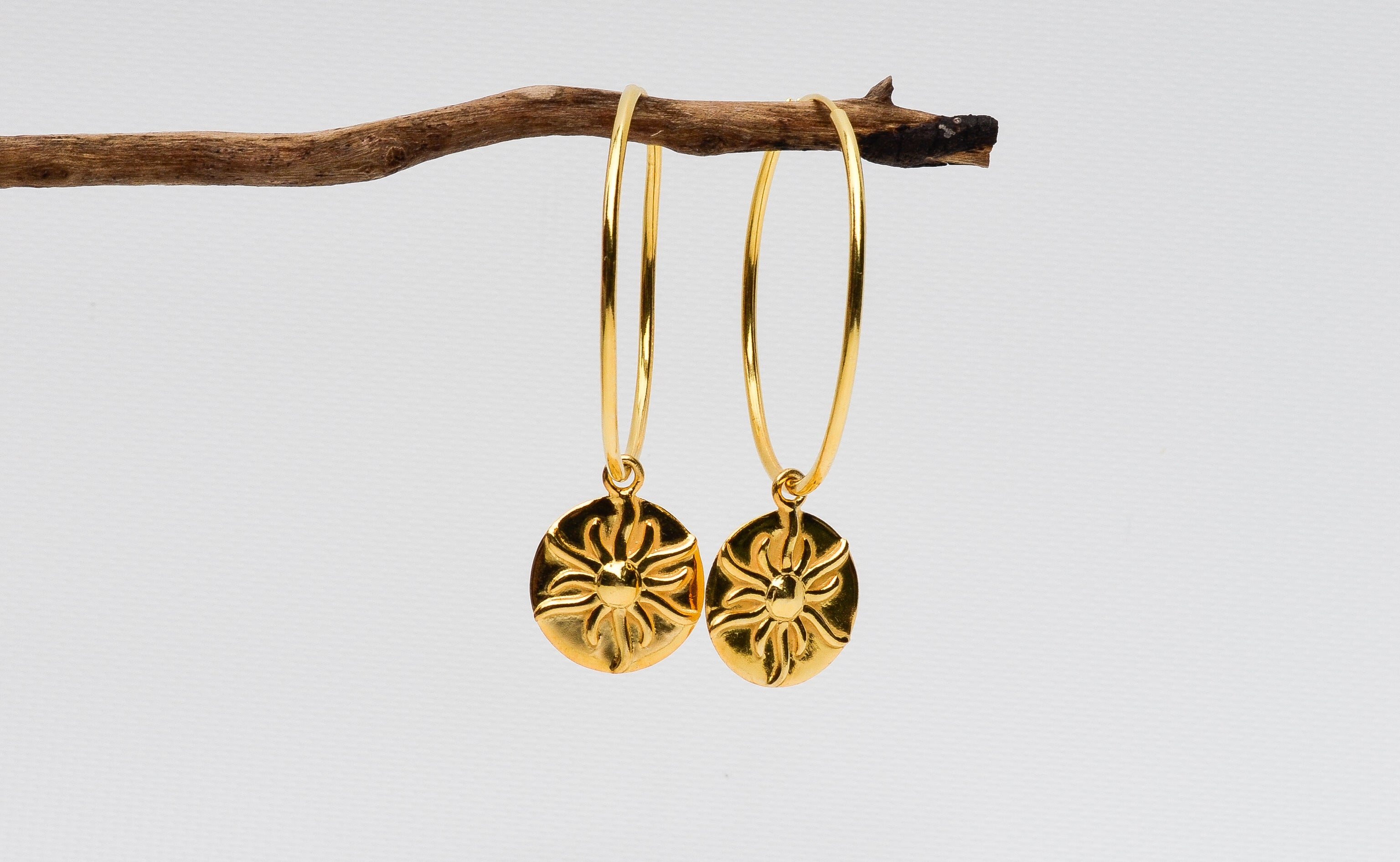 The Surya earrings are handmade out of sterling silver. Shop online at Nelumbo for unique rings, earrings and necklaces. Jewelry for women.
