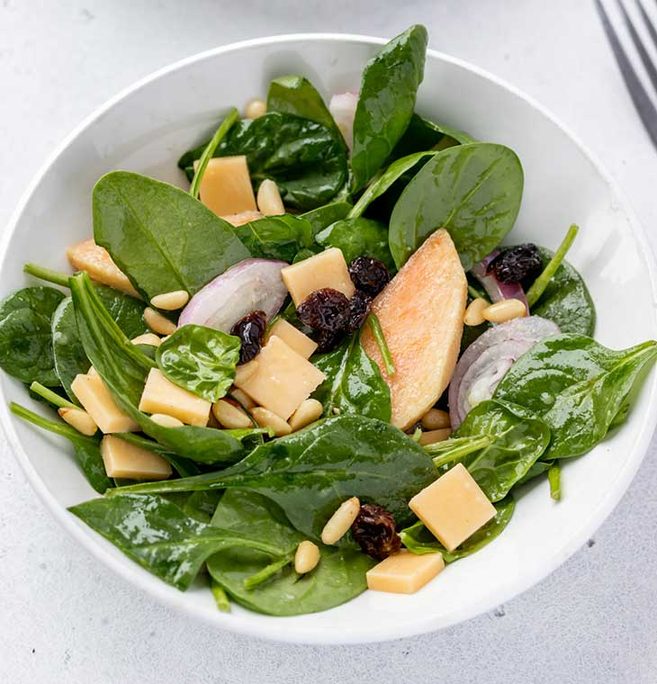 Spinach Sapodilla Salad with Pine Nuts and Gouda