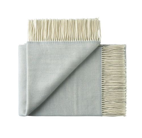 100% wool fringe throw rug in powder blue from Weave for New Zealand interiors