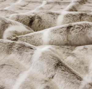 Luxury faux fur mountain rabbit throw in cream and brown from Heirloom.  These are the best fake fur throws, super soft for NZ interior design