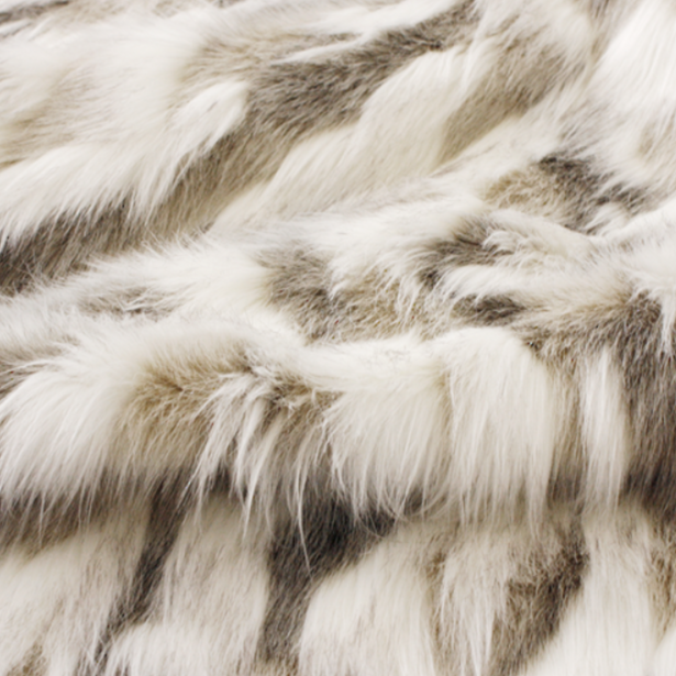 Luxury faux fur throw in cream and brown from Heirloom.  These are the best fake fur throws, super soft for NZ interior design. Snowhare.