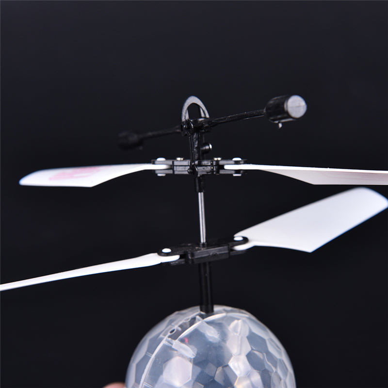 LED Toy Induction Suspension Fly Ball Helicopter Flash Glow RC Aircraft Kid Gift