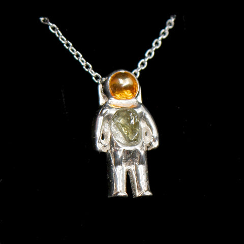 Sterling Silver astronaut pendant necklace with green moldavite glass and gold enamel helmet visor - the perfect space gift!