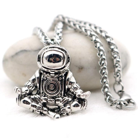 Astronaut necklace showing a spaceman meditating. The perfect space gift!