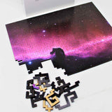 Space theme wooden jigsaw puzzle of the Horsehead Nebula Galaxy with unique geometric pieces.