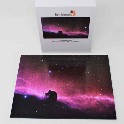 A space themed puzzle with geometric wood pieces showing the Horsehead Nebula galaxy. A great gift!