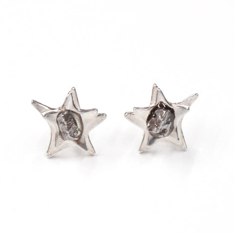 Space earrings in sterling silver with star shape and campo del cielo meteorite in center.