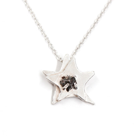 A space-themed necklace! Dual layered solid sterling silver star with a Campo del Cielo meteorite in the center.