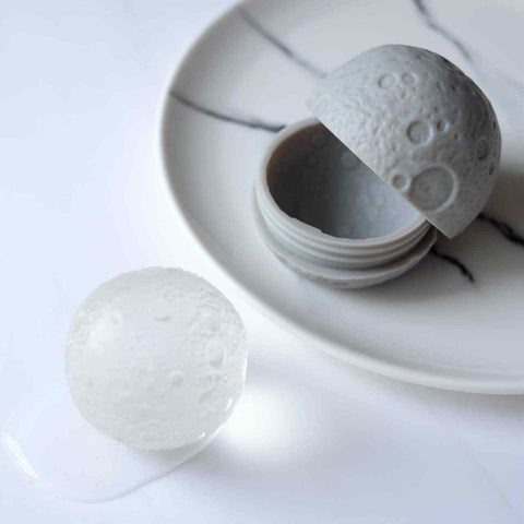 A silicone moon ice mold to make moon shaped ball ice cubes.