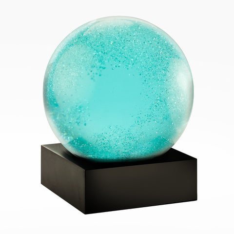 Moonlight snow globe made of glass with glittery blue snow inside that looks like moon light and stars! A gift for space lovers!