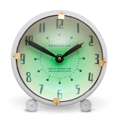 Spacey desk clock by Pendulux modeled after space age automobile dashboard clock! Green face with round convex front.