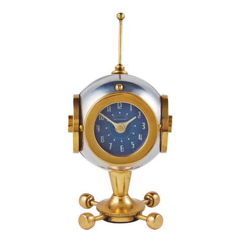 A cute space astronaut clock for your desk or table, by Pendulux with an aluminum and brass body, and a blue face, with an antenna on top to look like an astronaut helmet!