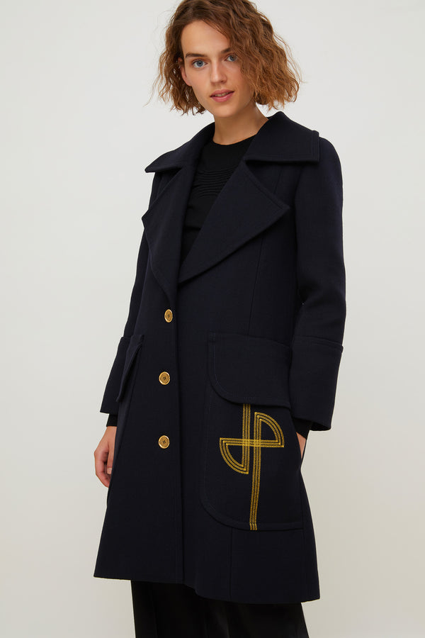 Image 1 of 6 - Longline virgin wool coat with embroidered logo