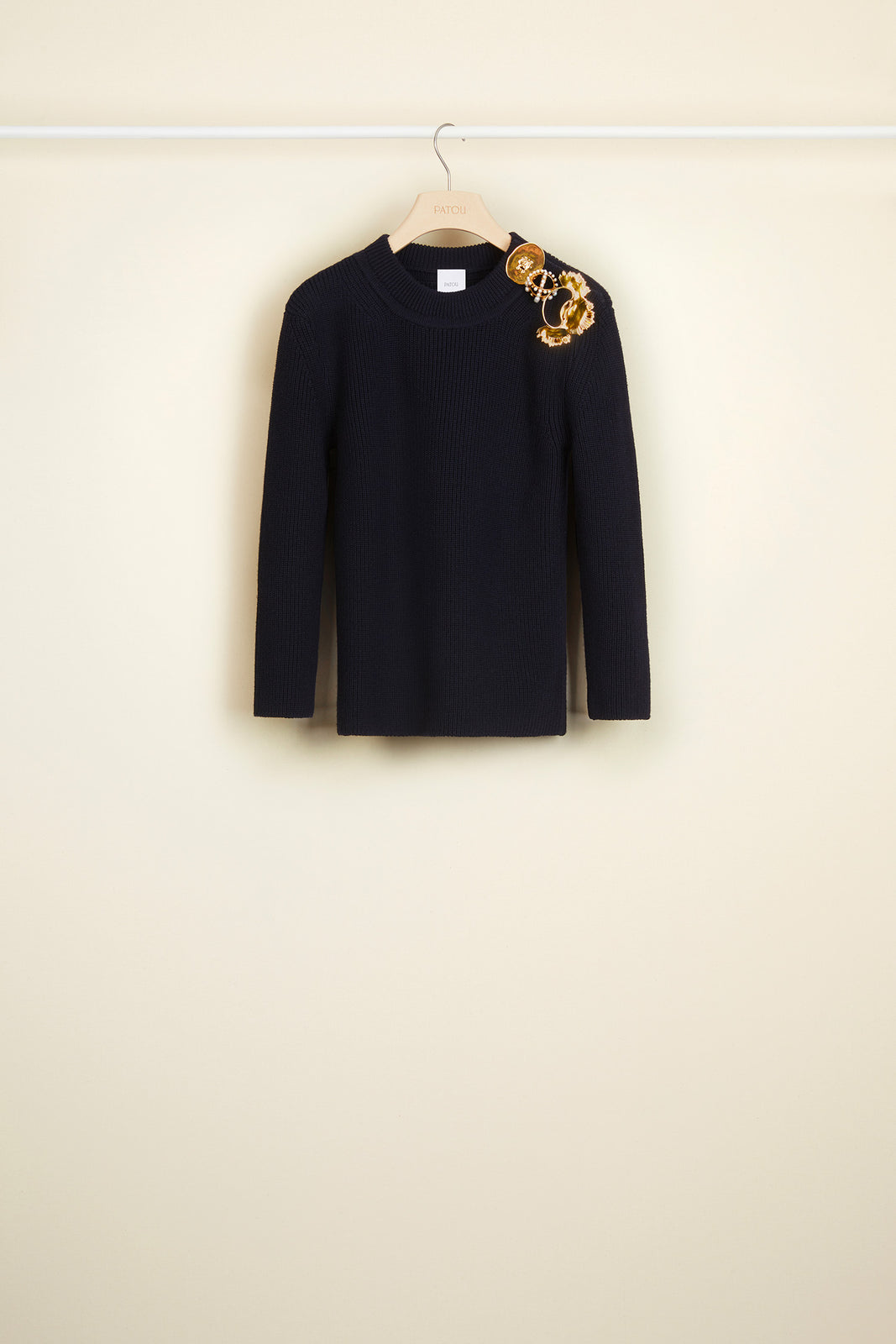 Merino wool jumper with brass and pearl brooches
