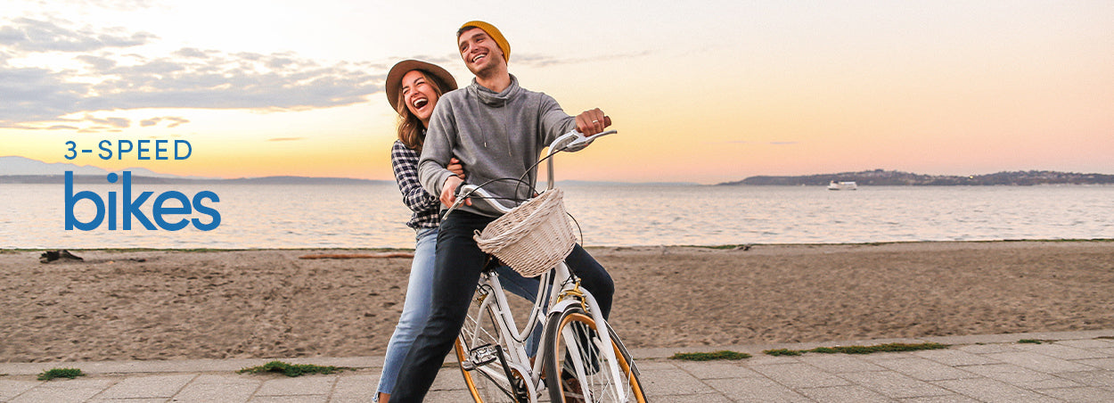 3-Speed Bikes | Couple at Sunset, riding a Kent Retro 700c together, laughing