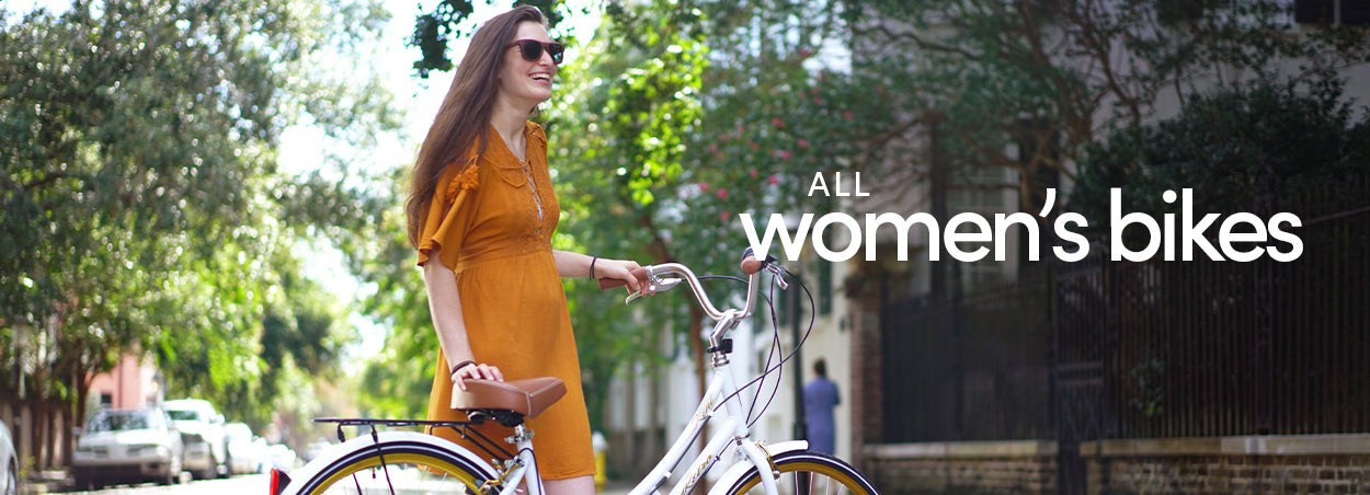 All Womens Bikes - Woman smiling with a White Kent Retro 700c