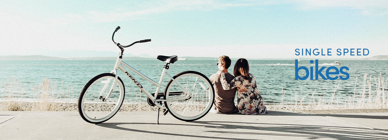 Single Speed Bikes | Couple Sitting on a beach side with a Kent Transit