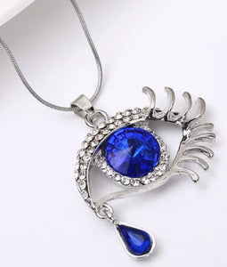 Eye Pendant Complimented With Rhinestones and A Teardrop Necklace
