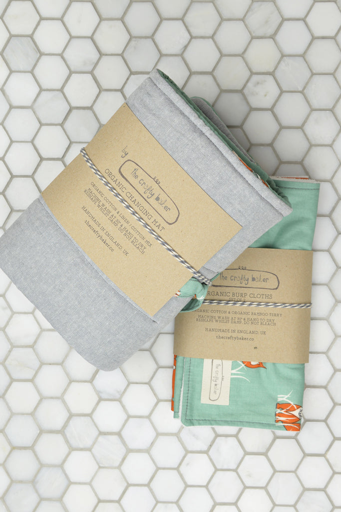Changing Mat and Burp Cloths (Sold Separately)