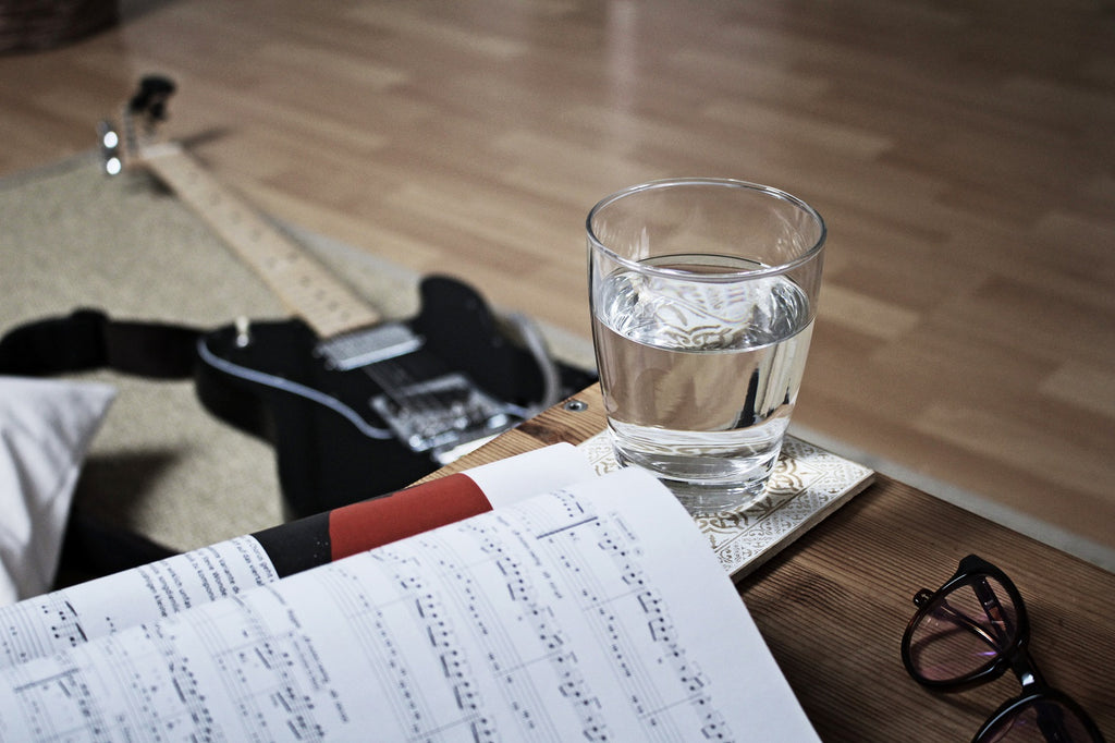 Guitar and a glass of water
