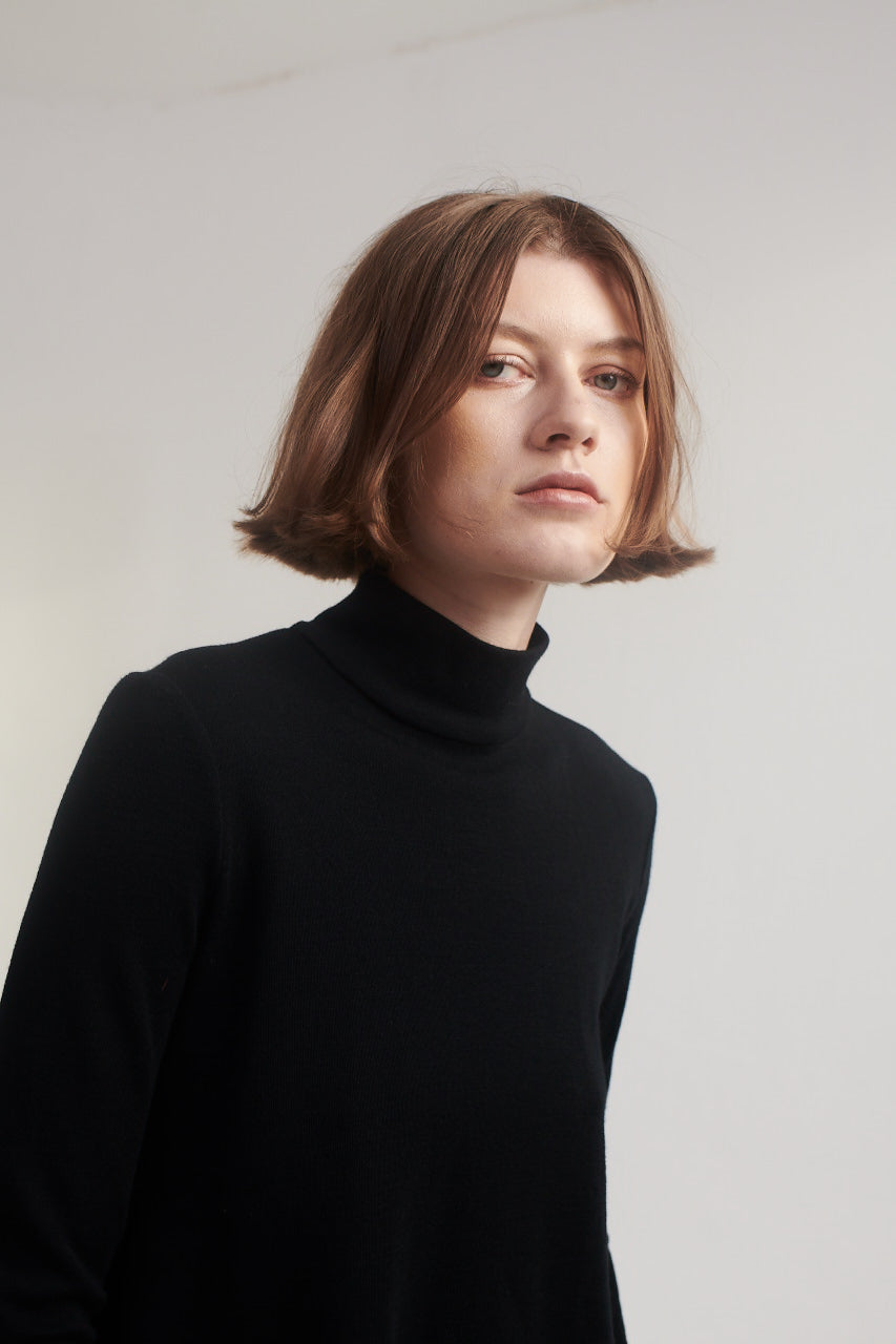 Turtle Neck Sweater in Black.