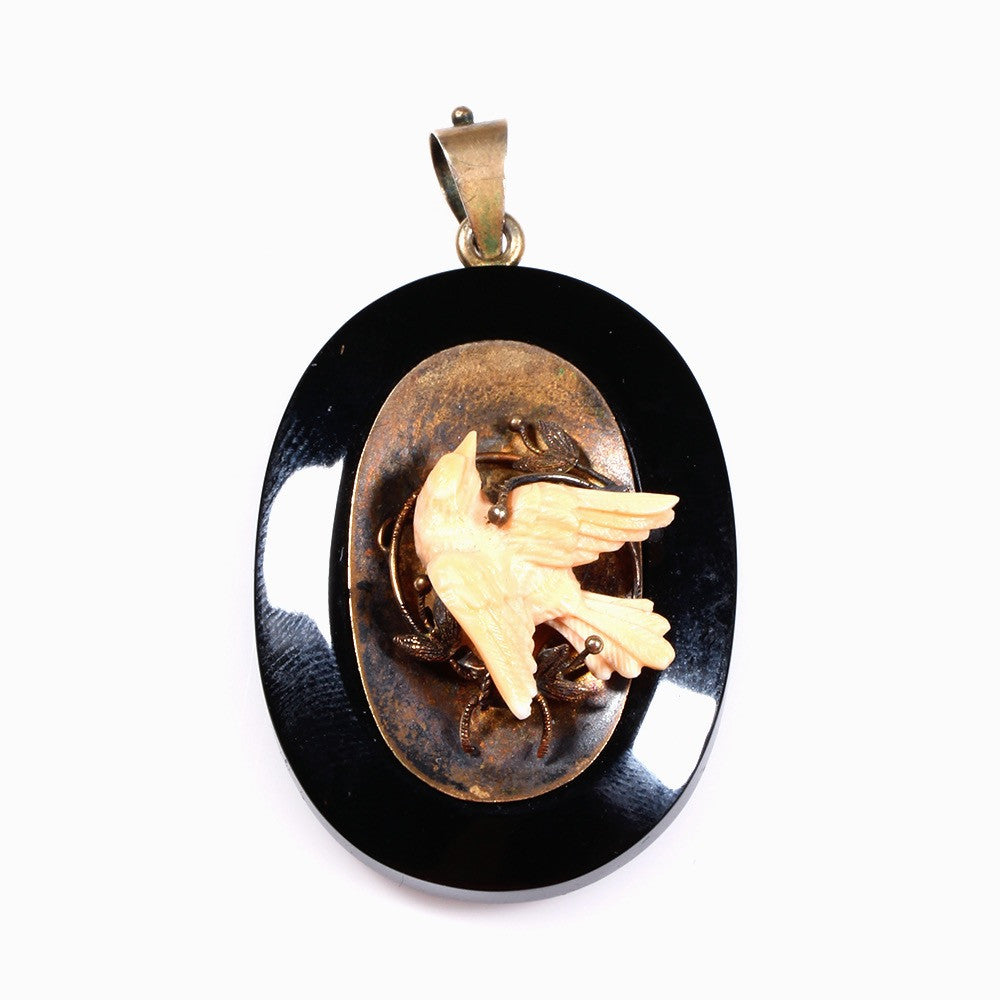 Black Onyx Locket with carved Angel skin Coral Bird in 14k Gold, circa 1870