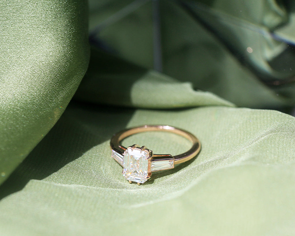 Tapered Baguette Three Stone Emerald Cut Diamond Ring