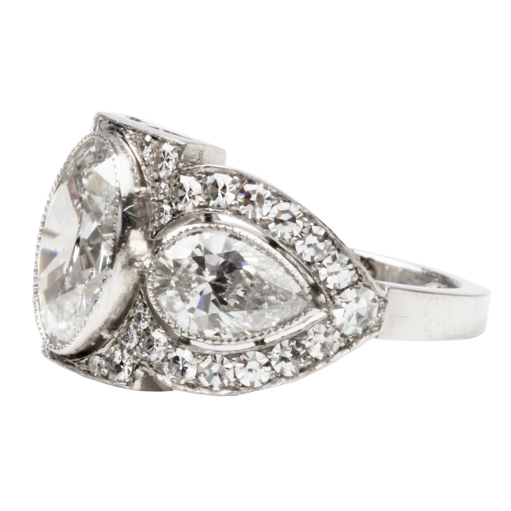 Art Deco Inspired Three Stone Diamond Ring with Oval and Pear Shapes