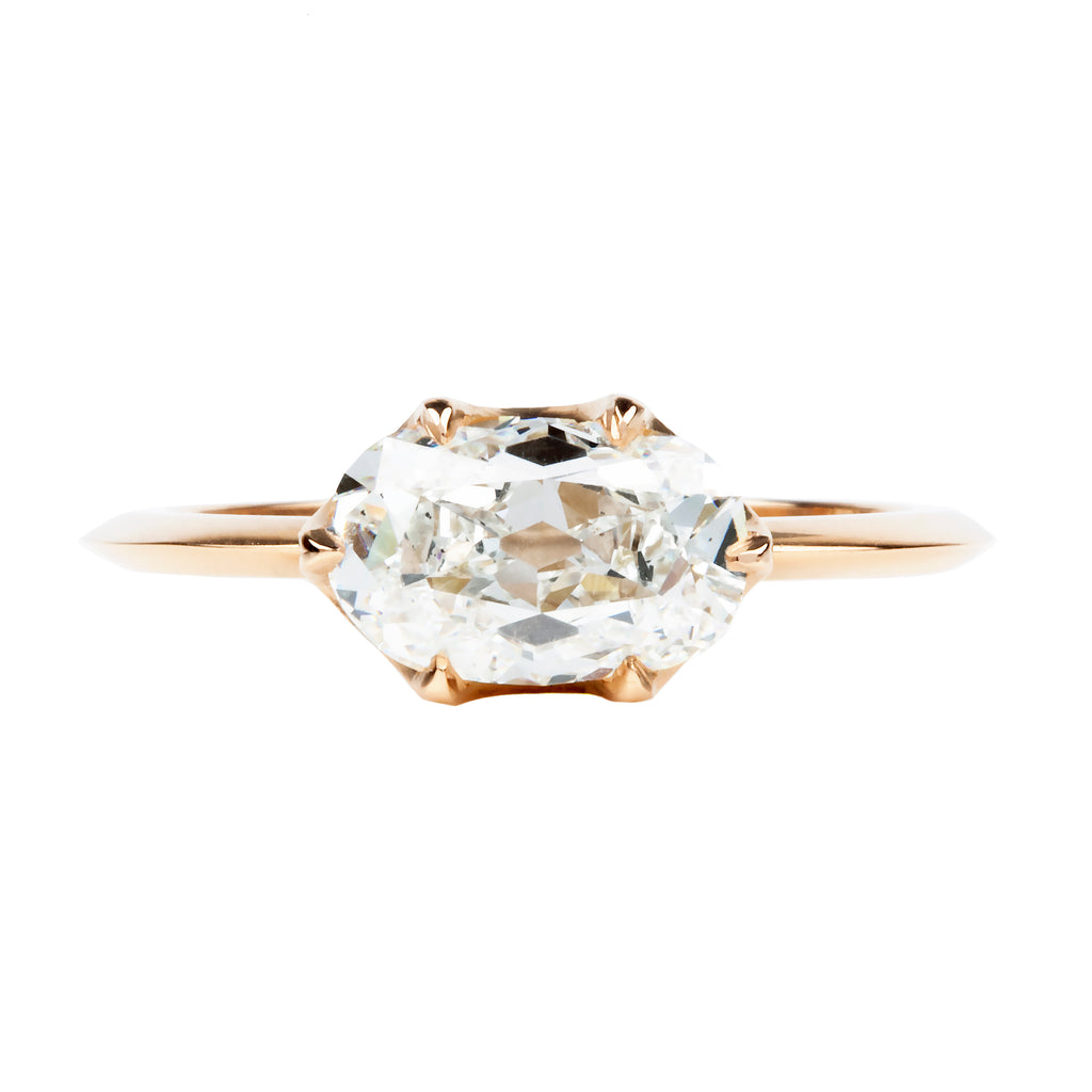 Elongated Old Mine Cut Diamond in Scalloped Prong Setting