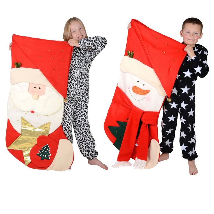 kids holding giant christmas stockings with santa and snowman designs