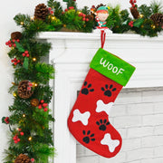paw print design dog stocking with woof text embroidered to the top