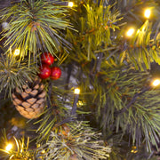 close up detail of warm white LED lights, pine cone and berry clusters\ with mixed pine branches