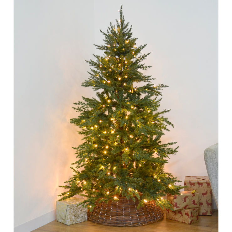 6ft pre-lit christmas tree in room setting with wicker tree skirt and gifts