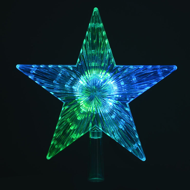 christmas star tree topper featuring green and blue lights in a dark room