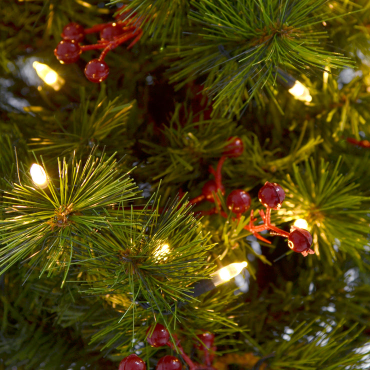 close up detail of warm white led lights and berry clusters