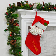 "24"" large christmas stocking with gold 'HO! HO! HO' embroidery on the front hanging on fire ledge with led garland"