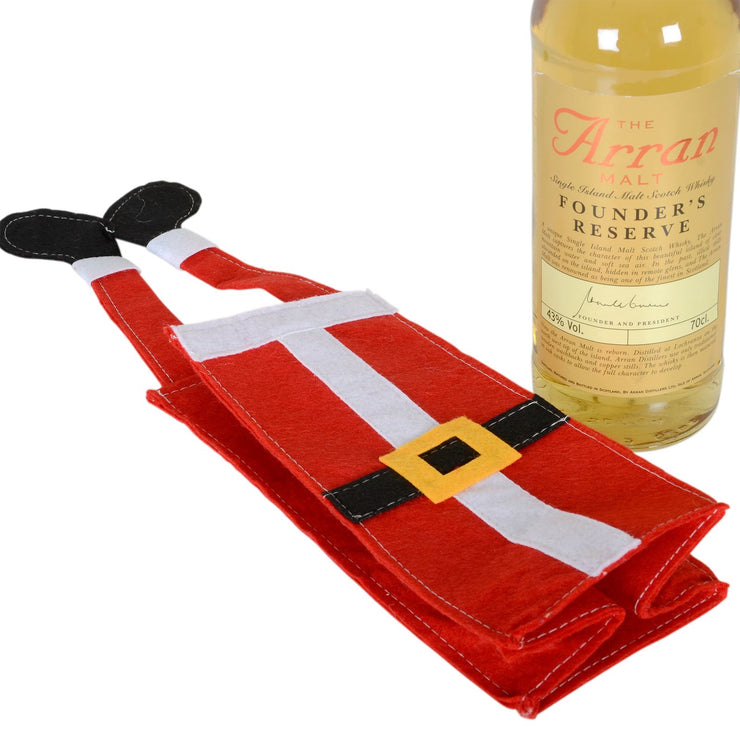 christmas gift bag folder flat with whisky bottle to the side