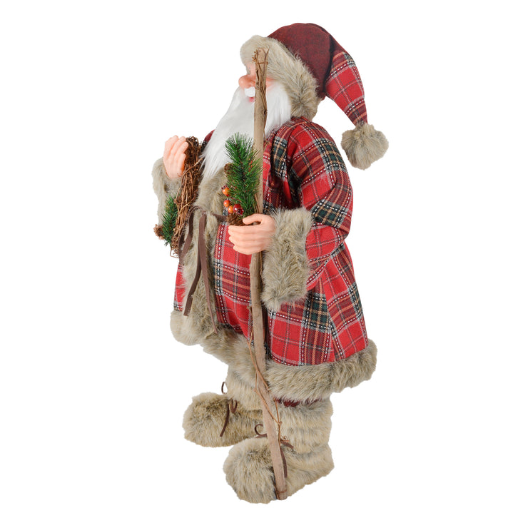 side view of plush santa with wreath