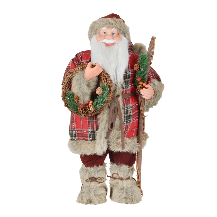 front view of santa with tartan jacket and carrying wicker wreath with pine cones and berries