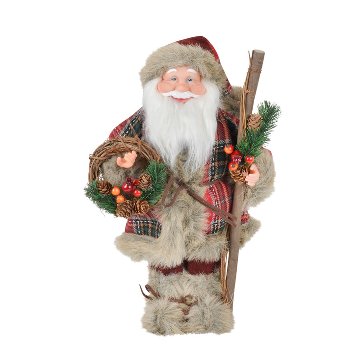front view of small santa carrying wicker wreath with pine cones and berries