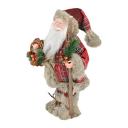 side view of plush santa figure with wreath