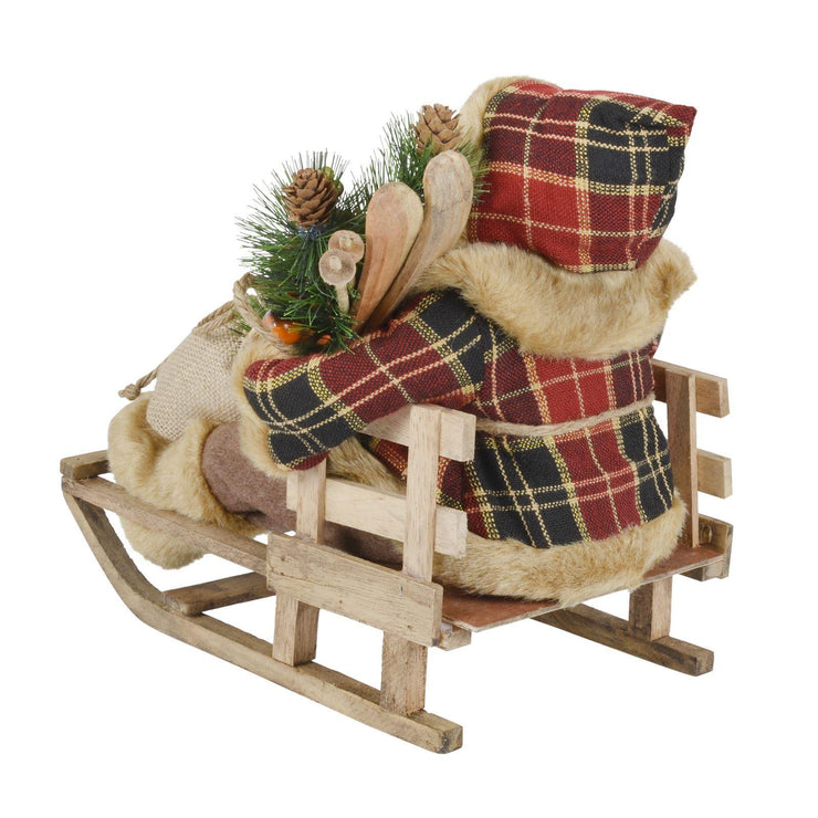 back view of santa on sleigh, showing wooden ski details and tartan jacket hood
