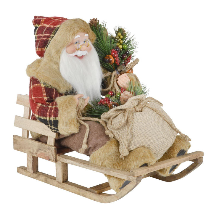 "13"" santa decoration on wooden sleigh holding a cute wicker bag of fruit and berries wearing tartan jacket and brown fluffy boots"
